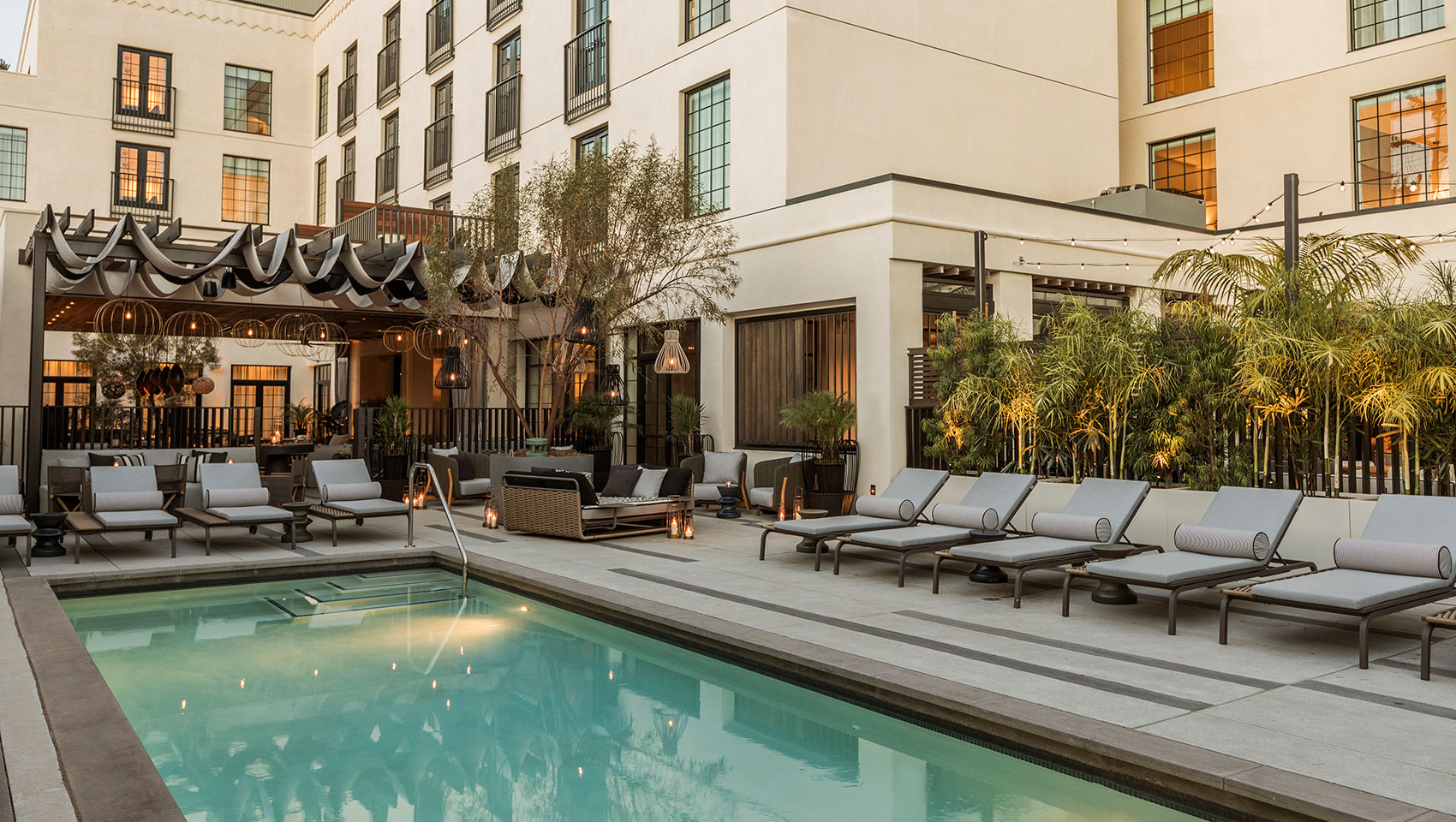 Pool and outdoor lounge at Kimpton La Peer Hotel